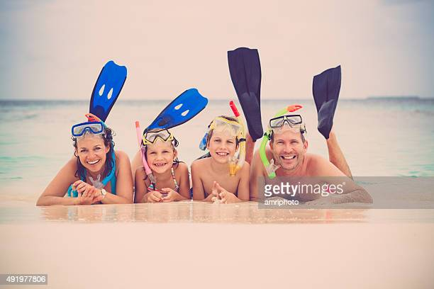 happy snorkeling family on vacation