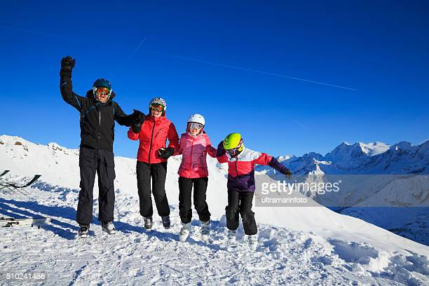 Happy Snow skier family mother and father with children  Alps