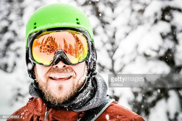 74eec083a35 Happy Snowboarder Wearing Helmet and Goggles at The Ski Mountain