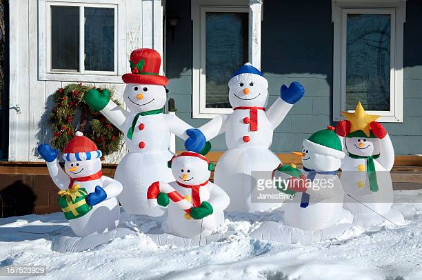 Happy Snowman Family Enjoying Winter Day Together in Snow, Sunshine