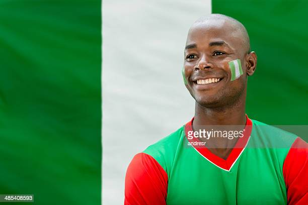 happy soccer fan - nigerian flag stock photos and pictures