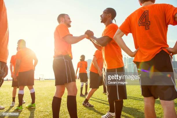 happy soccer team on field during sunny day - camisa de futebol - fotografias e filmes do acervo