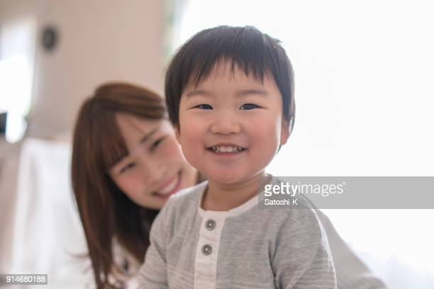 happy son and mother in living room - japan mom and son stock photos and pictures