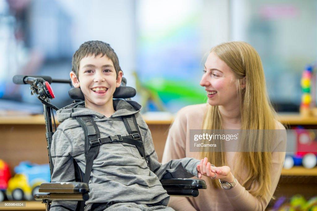 Happy Special Needs Boy : Stock Photo