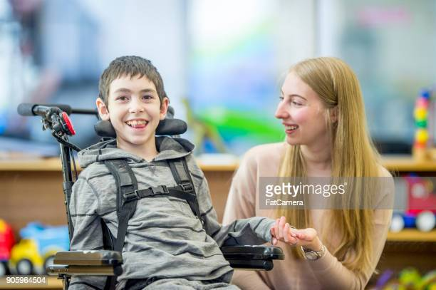 happy special needs boy - paraplegic stock photos and pictures