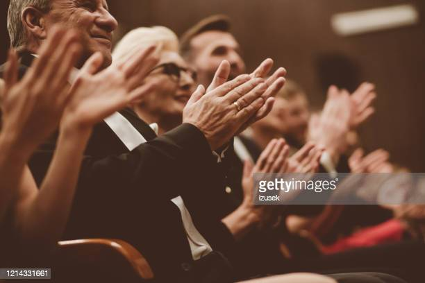 happy spectators clapping in the theater, close up of hands - formal stock pictures, royalty-free photos & images