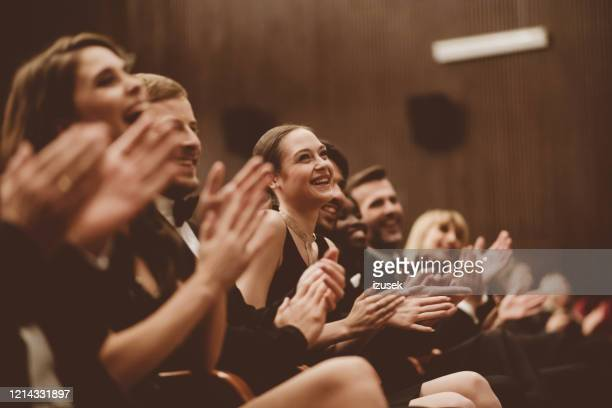 happy spectators clapping in the theater, close up of hands - applauding stock pictures, royalty-free photos & images