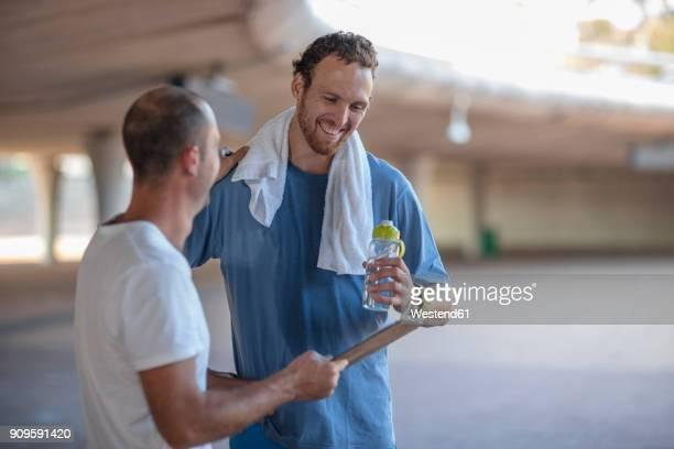 happy sportive man with his fitness coach after exercising - entraîneur photos et images de collection