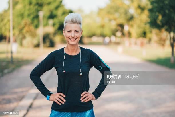 Happy sportswoman outdoors