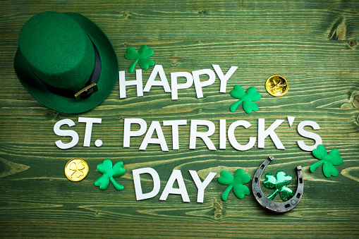 Happy St Patricks Day letters on green wooden background 1134171255