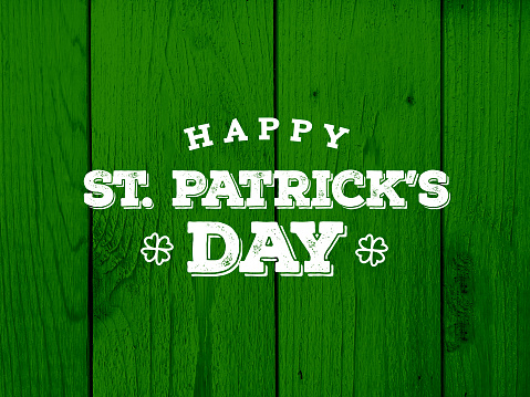Happy St. Patrick's Day Text Over Green Wood Texture 919483660