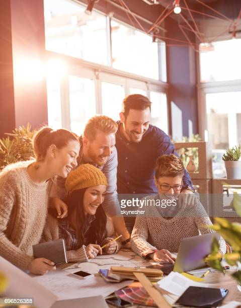 happy start up team working on laptop at casual office. - surfing the net stock photos and pictures