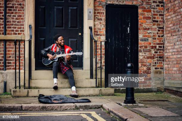 happy street busker - busker stock pictures, royalty-free photos & images