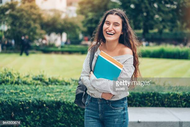 happy student outdoors in the city - textbook stock pictures, royalty-free photos & images