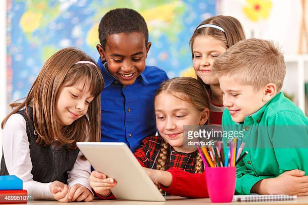 Happy Students In Classroom Using Digital Tablet