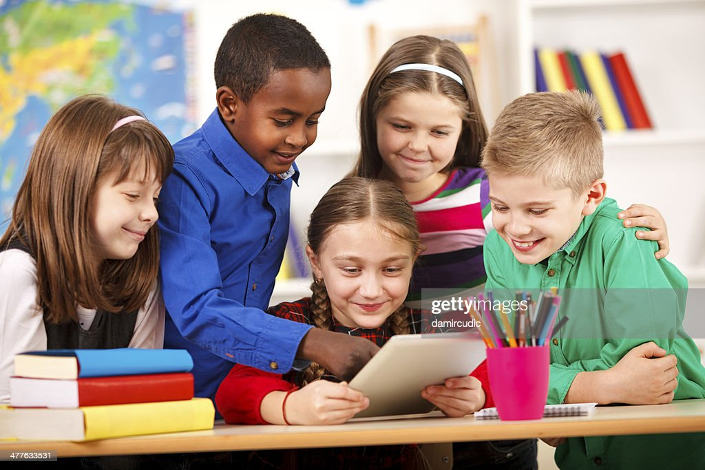 Happy Students In Classroom Using Digital Tablet : Stock Photo