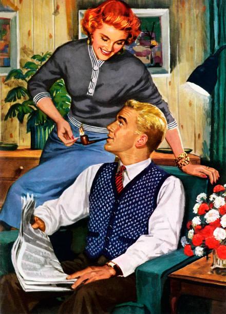 Happy suburban American housewife lighting her husband's...