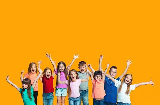 Happy success teensl celebrating being a winner. Dynamic energetic image of happy children 1006470432