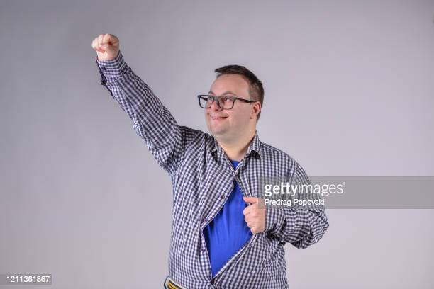 happy super hero with down syndrome on studio background - kumanovo stock pictures, royalty-free photos & images