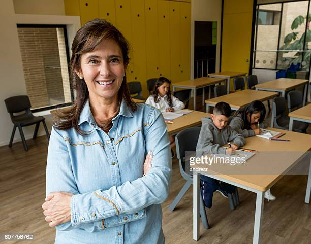 Happy teacher at the school