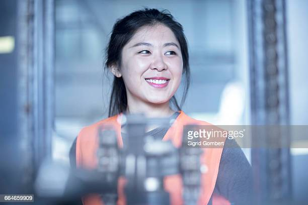 happy technician in factory - sigrid gombert stock-fotos und bilder