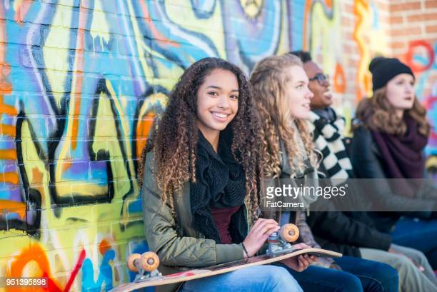 happy teen girl with friends - man made age stock pictures, royalty-free photos & images
