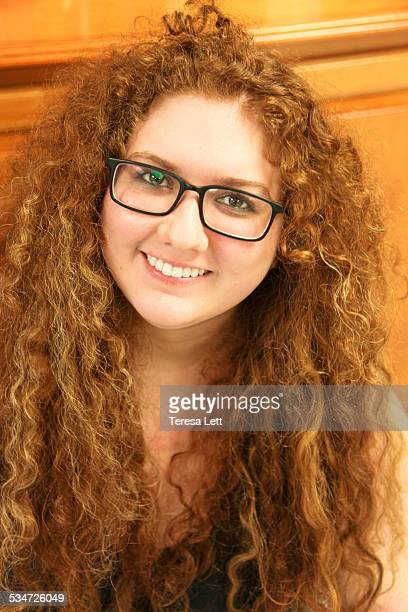 Happy teen girl with glasses