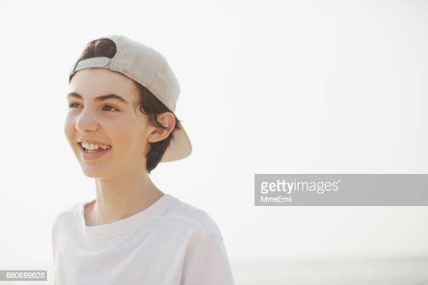 Happy Teenage Boy At The Beach