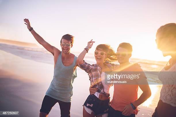 Happy teenage friends on beach