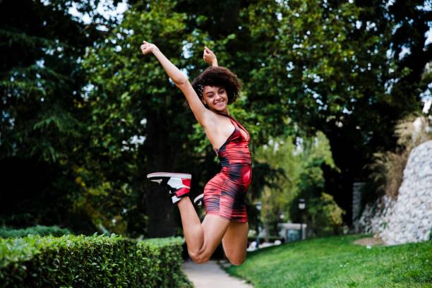 happy teenage girl dancing in the street