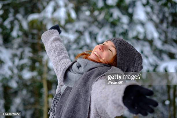 happy teenage girl enjoying the winter - one teenage girl only stock pictures, royalty-free photos & images
