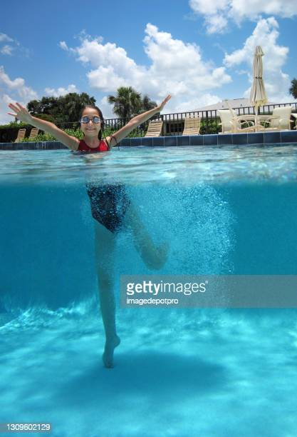 happy teenage girl in swimming pool - partially sighted stock pictures, royalty-free photos & images