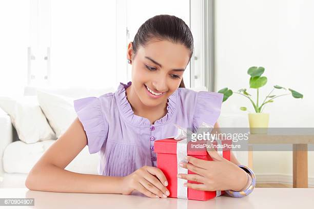 Happy Teenage Girls holding gift with ribbon