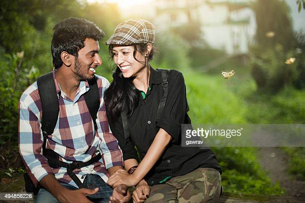 Happy teenage lovers of different ethnicity together in tranquil place.