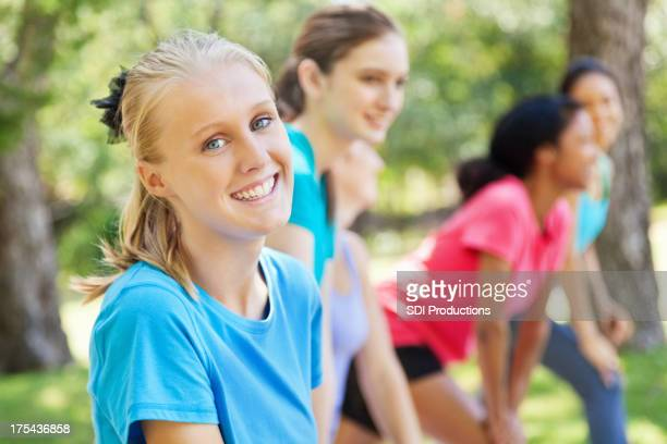 Happy teenager at an outdoor exercise class