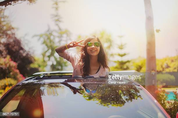 Happy teenager in sunroof outdoors