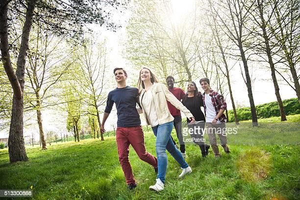 Happy teenagers having fun outdoor in springtime