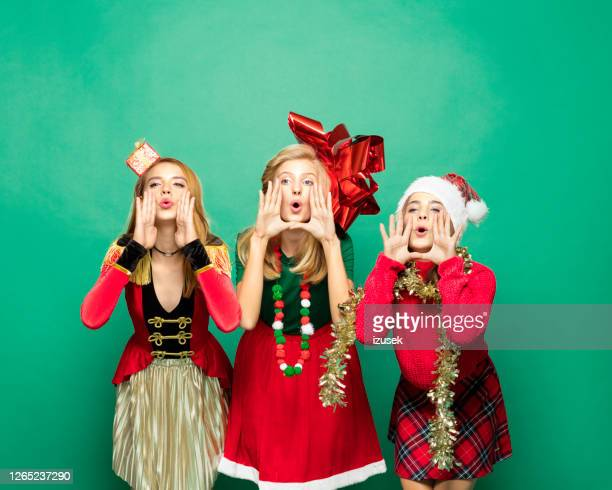 happy teenagers in funny christmas clothes - izusek stock pictures, royalty-free photos & images
