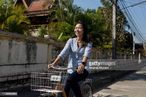 Happy Thai Woman Riding Bicycle with Basket