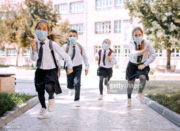 happy that school is finally back - reopening stock pictures, royalty-free photos & images