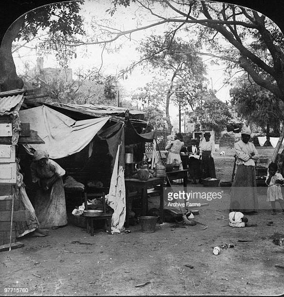 Happy though destitute refugees in temporary shelters at Parade Gardens Kingston Jamaica following the devastating earthquake of January 14 1907