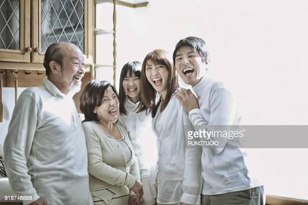 happy three generation family at home - 多世代家族 ストックフォトと画像