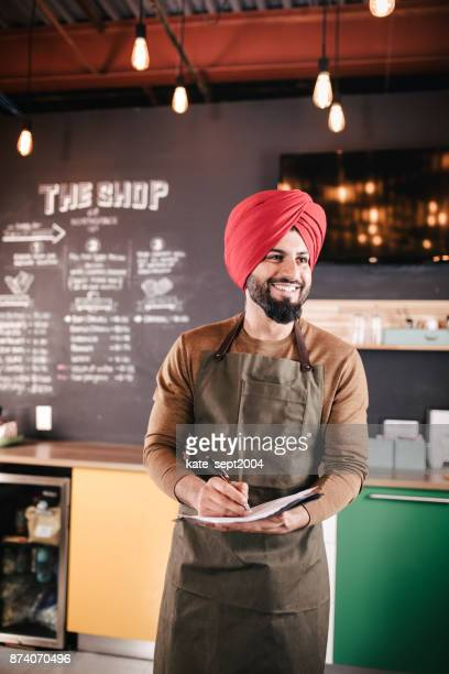 happy to see new customers - sikh stock pictures, royalty-free photos & images