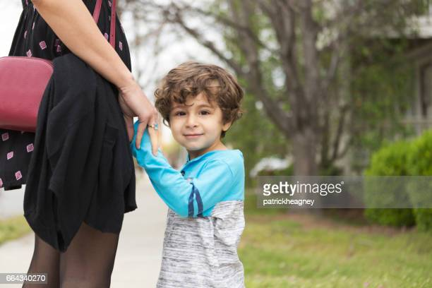happy toddler boy holding hands with a woman - iranian culture stock photos and pictures
