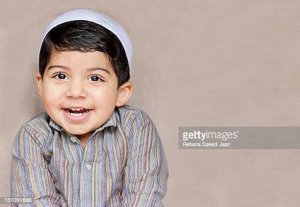 happy toddler boy - muslim boy stock photos and pictures