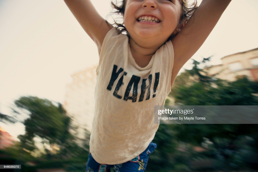 Happy toddler flying at the park : Foto de stock