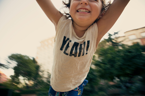 Happy toddler flying at the park - gettyimageskorea