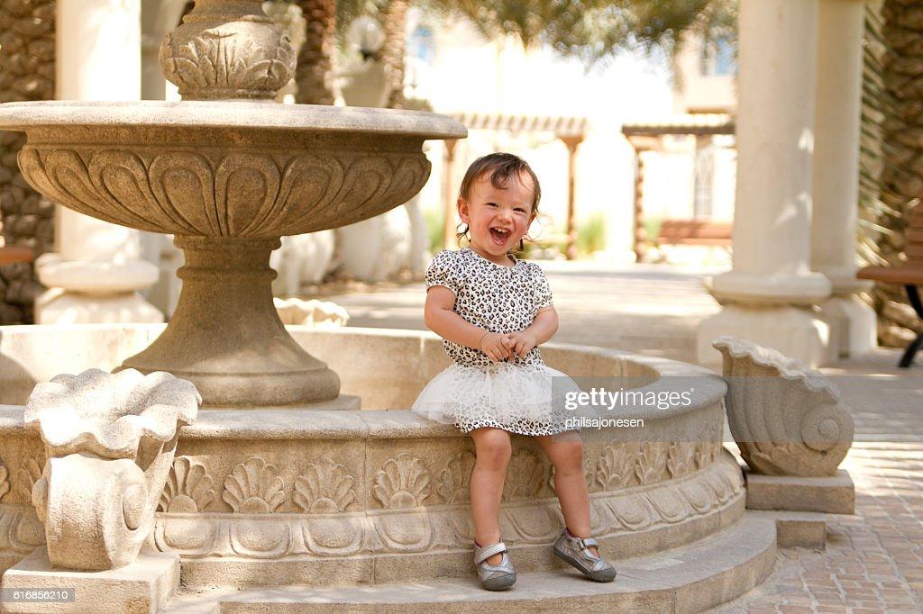 Happy Toddler Girl Sitting Outside : Stock Photo