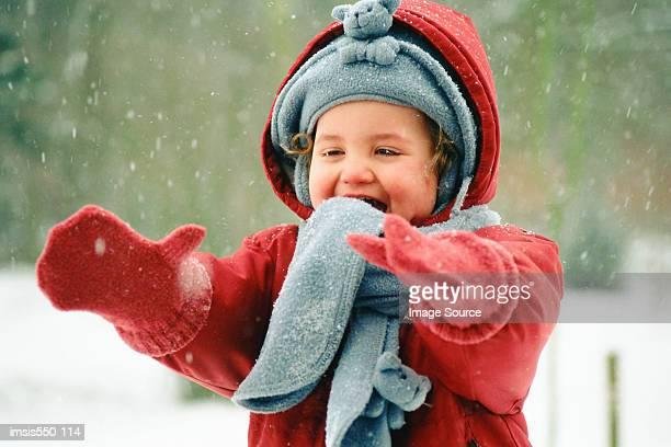 happy toddler in the snow - fleecejas stockfoto's en -beelden
