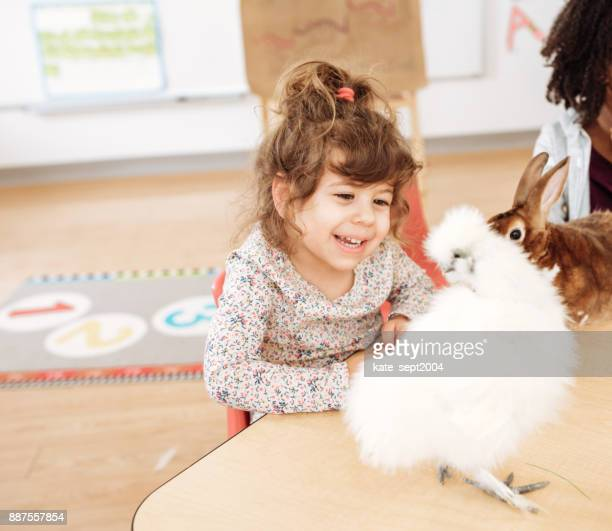 Happy toddler looking at chicken